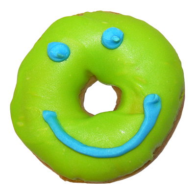 plain ring donut with green icing and smiley face