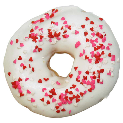 plain ring donut with white icing and heart sprinkles